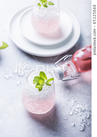 Pink cocktail with crushed ice 65125688