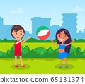 Kids Playing Volleyball in City Park Cityscape 65131374