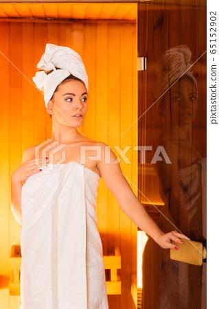 Woman white towel in sauna room 65152902