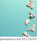 Sea stones isolated on emerald green background. Summer marine decoration. flat lay, top view, copy space 65176245