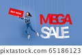 Excited woman puppet with MEGA SALE sign 65186123