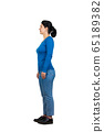 Full length side view of casual young woman 65189382