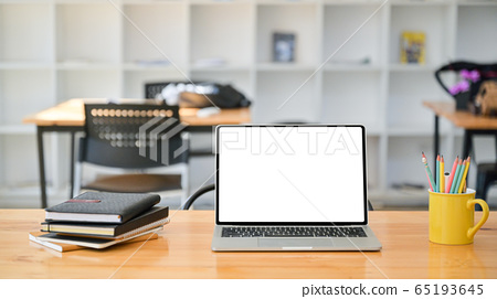Cropped shot of Laptop with notebooks and 65193645