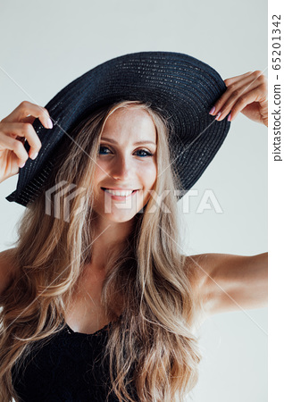 blonde girl with blue eyes a hat with a brim on a white background 65201342