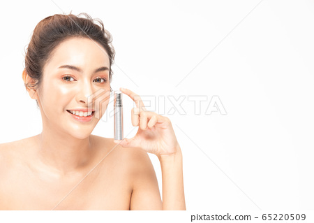 Beauty asian woman  brown hair looking smile in camera happiness and hold bottle cosmetic cream lotion  and cheerful with make up brush,Beauty Concept on white background. 65220509