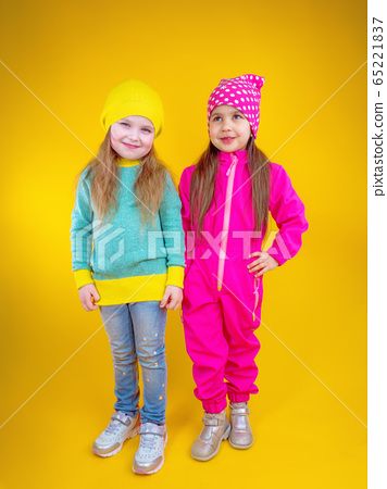 Cheerful little girls in trendy colorful clothes 65221837