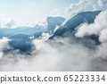 Photo of atmospheric blue misty mountains with 65223334