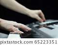 Close up of a man's hands playing and mixing on 65223351