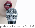 Close up of a young woman with red lips singing to 65223359