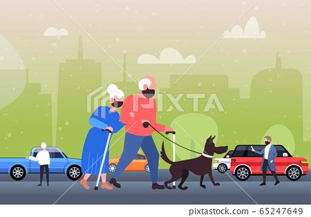 mature couple walking with dog senior man woman wearing mask to prevent coronavirus pandemic 65247649