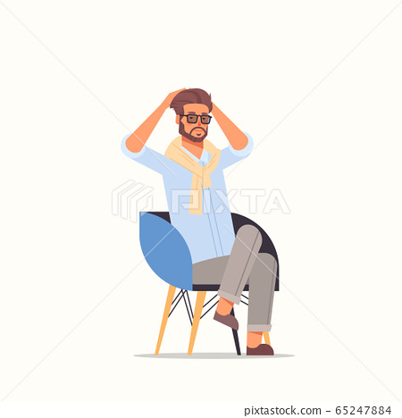 tired businessman holding hands on head business man feeling stress pain sitting on armchair 65247884