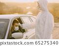 Person in a protective suit checks the temperature 65275340
