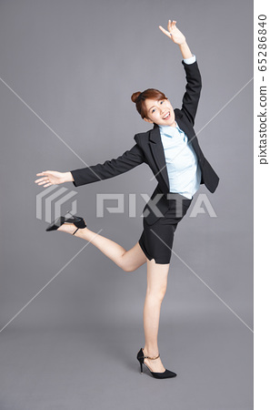 happy young business woman dancing for  success 65286840