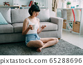 Attractive young asian japanese woman at home 65288696