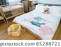 view of master bedroom with some baby clothes 65288721