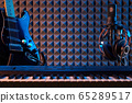 Electric guitar, piano and microphone with professional headphones 65289517