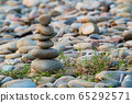 Pyramid of pebbles on the beach. 65292571