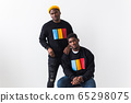 Street fashion and friendship concept - Two african american young men in black stylish sweatshirts. 65298075