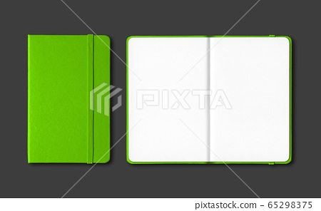 Green closed and open notebooks isolated on black 65298375