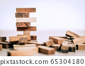 Business success and risk concept with block 65304180