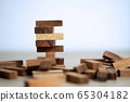 Business success and risk concept with block 65304182