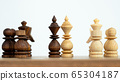 Business leader and battle concept with chess 65304187