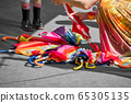 colourful umbrellas and parasols on the floor 65305135