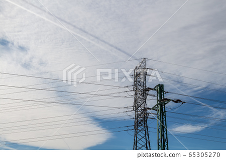 Electricity tower and two trails 65305270