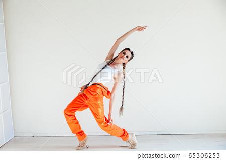 beautiful fashionable dancer dances to music portrait 65306253