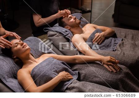 cute caucasian couple relax at face lift, massage procedure 65306689