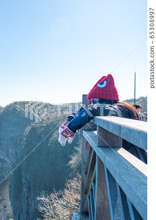 Young female enjoying good view from top of Tianmen mountain 65308997