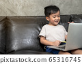 A home distance learning, boys studying online with notebooks at home, home school concept 65316745