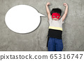 The boy in the superhero outfit smiled with his hands showing his strength, with a popup for the message beside him. 65316747