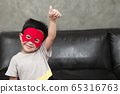 The boy in the superhero outfit smiled with a thumbs up, saying that he was very good..Study concepts And development of young children 65316763