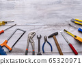 Set of work tool on gray wooden 65320971