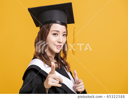 side view  young woman in graduation gowns and 65322588