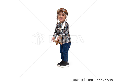 Happy kid Asian boy playing with toy airplane 65325549