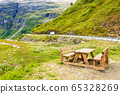 Camp site with picnic table in norwegian mountains 65328269