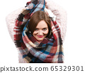 Woman wearing scarf isolated 65329301