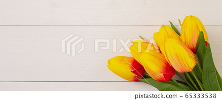 Beautiful tulip flower on wooden background with romantic, mother day or valentine day 65333538