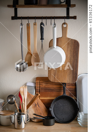rustic kitchen utensils on wooden counter 65336172