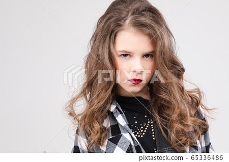 Cute baby girl rock star playing electric guitar 65336486