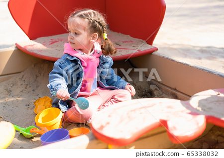 Cute little caucasian girl on the playground, 65338032