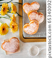 Top view of delicious heart-shaped donats on light background 65340092