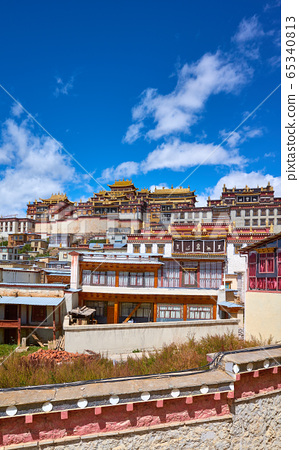 Ganden Sumtsenling Monastery on a sunny day, 65340813