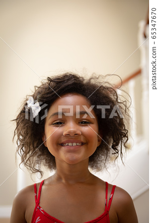 Young mixed race girl smiling to camera 65347670