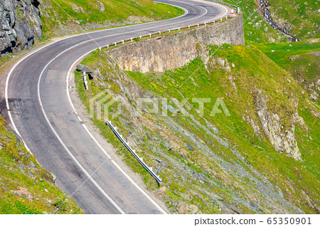 winding mountain road on a sunny day. empty 65350901