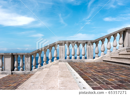 Stairway with white balustrade with seascape and blue sky with clouds 65357271
