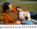 Loving father looking at his cute sleeping daughter 65378300