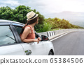 Relaxed happy traveler, Young beautiful girl 65384506